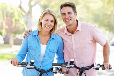 Couple are riding a bike